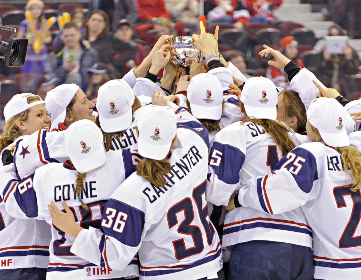 Ottawa, Canada - APRIL 9, 2013: Members of Team USA touch the IIHF Women's Championship Trophy after defeating Team Canada 3-2 to win the 2013 IIHF Women's World Championship at Scotiabank Place on April 9, 2013 in Ottawa, Canada.