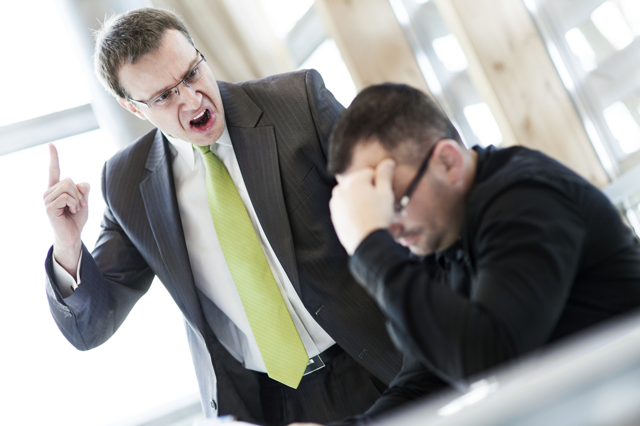 Angry businessman / office worker shouting at his subordinate with an expressive look.