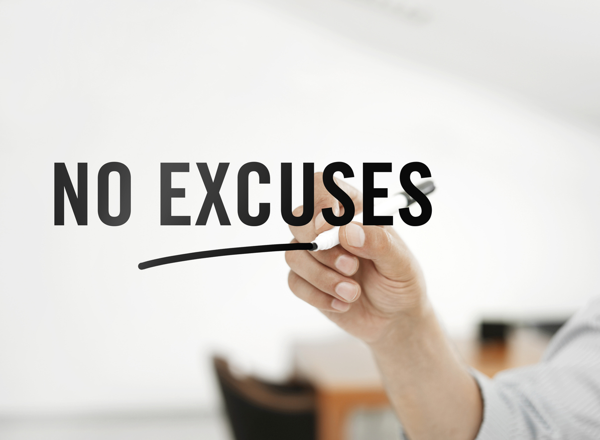 "Businessman writing ""No excuses"" on a virtual board"