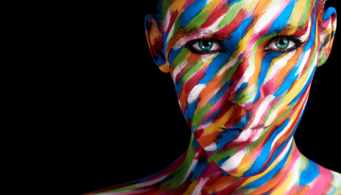 Cropped portrait of a young woman posing with paint on her face